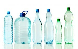 Six different bottles of pure, mineral water, isolated on white, with reflections.
