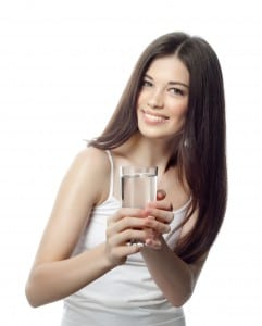 portrait of attractive caucasian smiling woman isolated on white studio shot with water